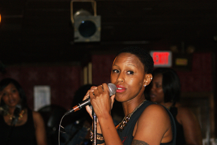 Wilson sings at an artist showcase. Photo by Leon Laing.
